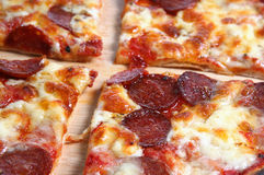 Pepperoni Pizza. Closeup of a freshly baked and sliced Pepperoni Pizza Stock Images