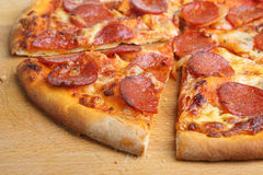 Pepperoni Pizza. Close-up of sliced thin-crust pepperoni pizza Stock Photo