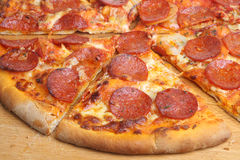 Pepperoni Pizza. Close-up of thin-crust pepperoni pizza Royalty Free Stock Photo