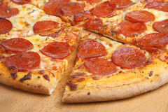 Pepperoni Pizza. Freshly baked pepperoni pizza cut into slices Stock Image