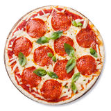 Pepperoni Pizza. With basil leaves isolated on white background royalty free stock photo