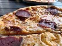Pepperoni pizza with cheese. Pepperoni pizza from one of Sweden`s barbecue bars in Falköping stock images
