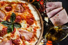 Pepperoni pizza fattening meat meal. Pepperoni pizza. Fattening and delicious meal with lots of meat royalty free stock image