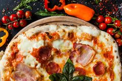 Pepperoni pizza fattening meat meal. Pepperoni pizza. Fattening and delicious meal with lots of meat stock photos