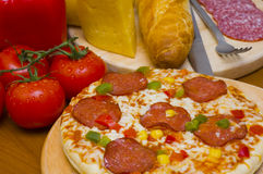 Pepperoni pizza and ingredients Royalty Free Stock Photography