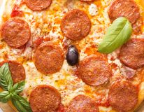 Pepperoni pizza. With basil close up royalty free stock photos