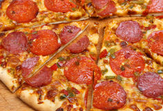 Pepperoni Pizza. With red and green chillies Stock Images