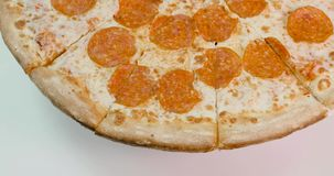 Pepperoni pizza revolves around its axis.  stock video