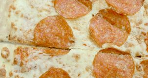 Pepperoni pizza revolves around its axis closeup video 4k.  stock video footage
