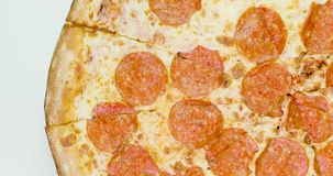 Pepperoni pizza revolves around its axis.  stock footage