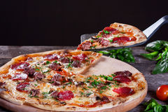 Pepperoni Pizza with salami, mushrooms , meat , beef and green o Stock Images