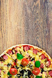 Pepperoni Pizza with Sausage, Cheese, Mozzarella, Olives and Bas Royalty Free Stock Images