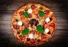 Pepperoni Pizza with Sausage, Cheese, Mozzarella, Olives and Bas Royalty Free Stock Photo