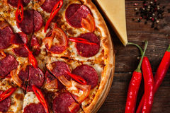 Pepperoni pizza served on rustic wooden table. Pizza Fast Food Restaurant Menu Ingredients Italian Cuisine National Concept Stock Photography