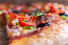 Pepperoni Pizza A Shallow Depth of Field Close up Food Photography. Pepperoni Pizza A Shallow Depth of Field Close up pepperoni, cheese, olive. Stock Food Royalty Free Stock Photos