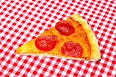 Pepperoni Pizza Slice on Red Gingham Stock Photo
