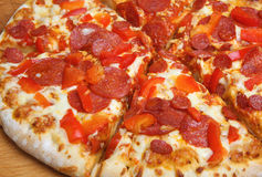 Pepperoni Pizza Sliced Royalty Free Stock Images