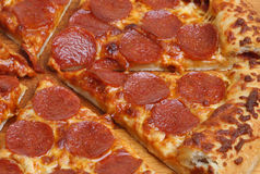 Pepperoni Pizza Sliced Stock Image