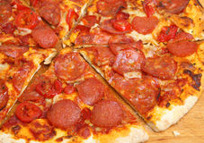 Pepperoni Pizza Sliced Royalty Free Stock Photography
