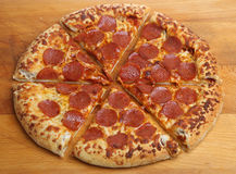 Pepperoni Pizza with Stuffed Crust. Pepperoni salami pizza with a suce filled crust Royalty Free Stock Photos