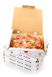 Pepperoni pizza in a takeaway pizza box. Whole pepperoni pizza in an open cardboard takeaway pizza box waiting for delivery from the pizzeria to a customer at Royalty Free Stock Images