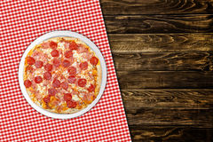 Pepperoni pizza on wood table Stock Image