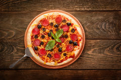 Pepperoni pizza on wooden table Stock Photography