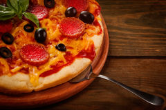 Pepperoni pizza on wooden table Stock Photos