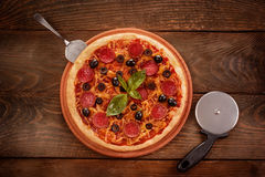 Pepperoni pizza on wooden table Royalty Free Stock Photography