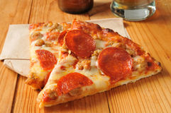 Pepperoni and sausage pizza Stock Photos