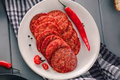 Pepperoni slices with chili pepper stock photo