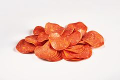 Pepperoni slices. Ingredients for pizza. Sausage. royalty free stock image