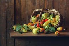Peppers. Натюрморт с перцами, высыпавшиеся из корзины Stock Photo