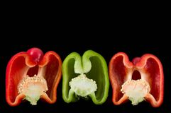 Peppers 1. Group of colorful bell peppers on a black background stock image
