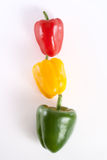 Peppers. Green red yellow fresh peppers  isolated on white background Stock Images