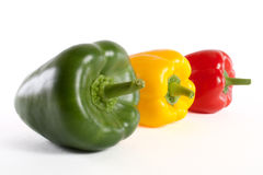 Peppers. Green red and yellow fresh pepper isolated on white background Royalty Free Stock Photos