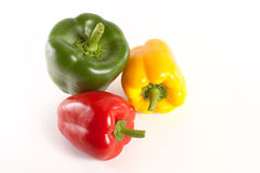 Peppers. Green red and yellow fresh pepper isolated on white background Royalty Free Stock Photo