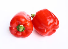 Peppers. Two red peppers on white background Stock Images