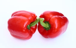 Peppers. Two red peppers on white background Stock Photos