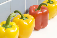 Peppers. Four Peppers Side By Side Stock Photo