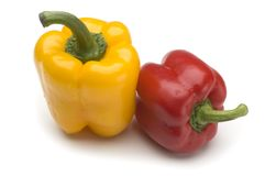 Peppers. Yellow and red pepper close up on white background Royalty Free Stock Photo