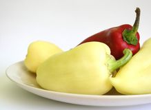 Peppers. Red and yellow peppers on a plate Royalty Free Stock Image