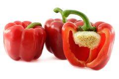 Peppers. Red sweet peppers over white background Royalty Free Stock Image