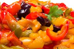 Peppers. In a frying pan with black olives Royalty Free Stock Image