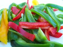 Peppers. Sliced red, green and yellow bell peppers Royalty Free Stock Image