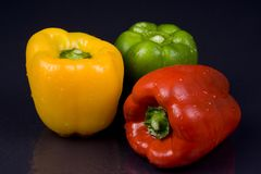 Peppers. Wet peppers on a black background Royalty Free Stock Images