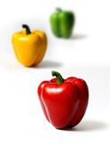 Peppers. Three peppers in different colors on white background royalty free stock images