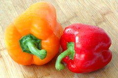 Peppers. Red and orange peppers stock images