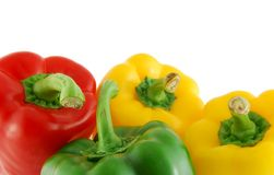 Peppers. A few peppers on the white background. Red, green and yellow stock image
