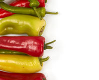 Peppers. On white, space for messages, different peppers royalty free stock images